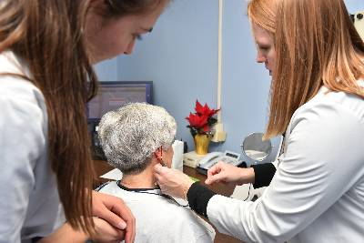 audiologists working with patient