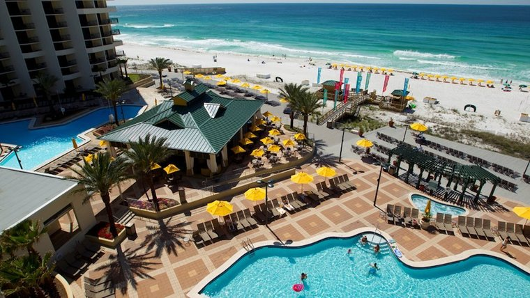 destin hilton hotel with view of pools
