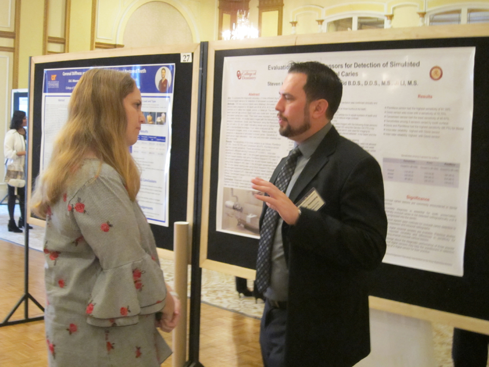 hinman researcher answering questions from attendee