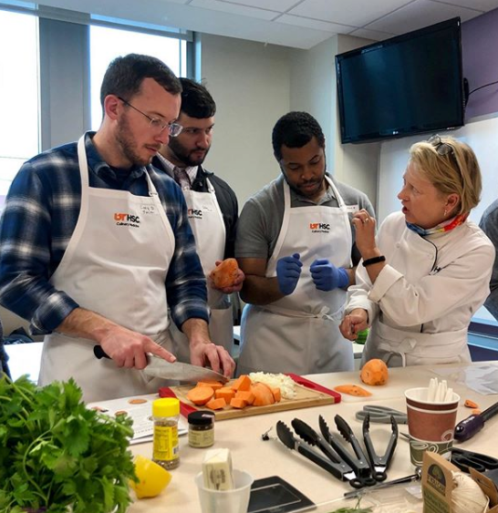 Residents in a kitchen learning about culinary medicine