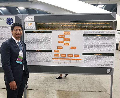 Resident in front of a poster presentation