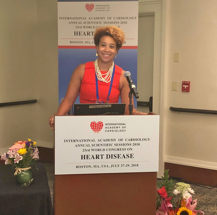 Female resident at the podium of the/internal/research/images/presentation.jpg Heart Disease conference