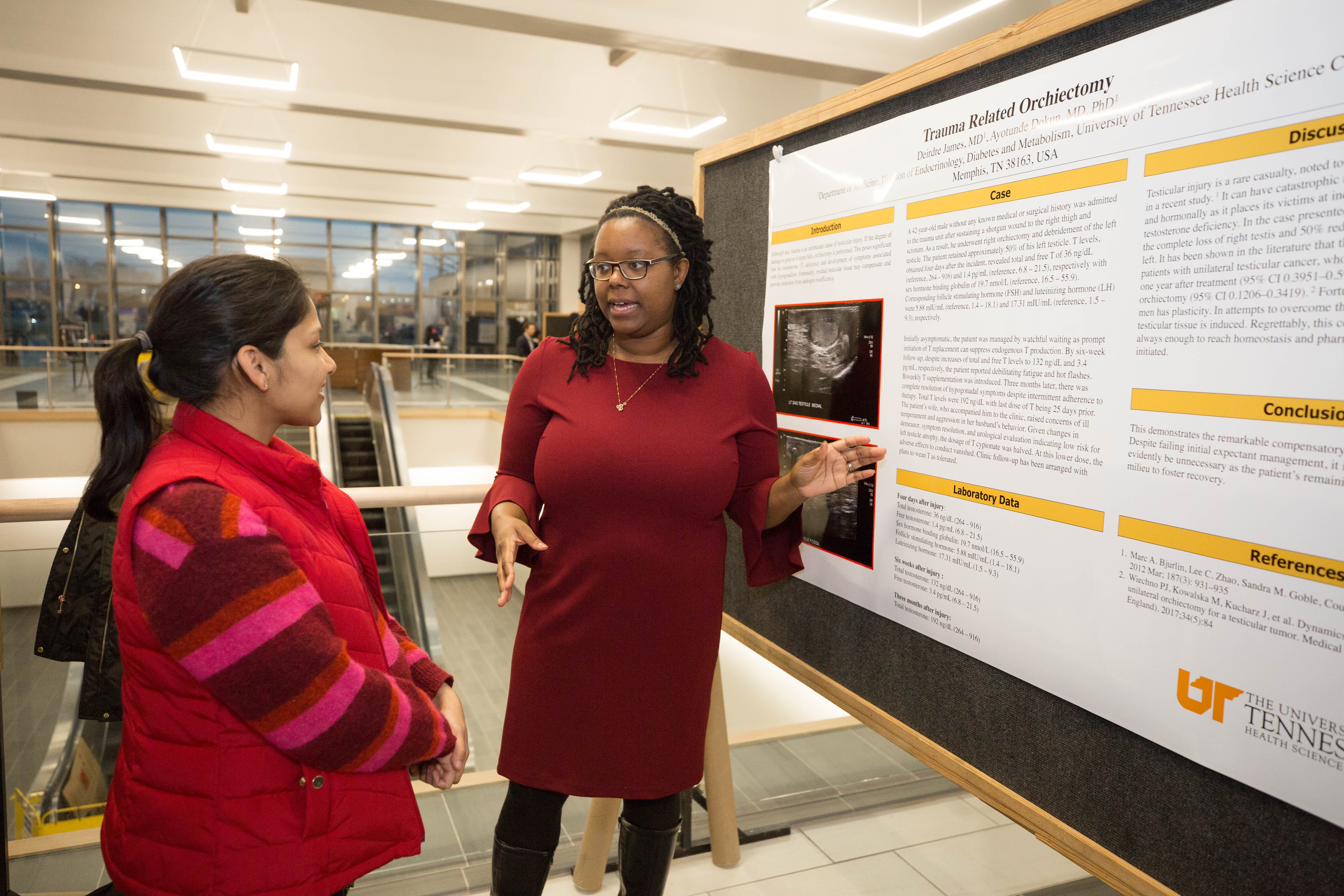 Resident talking about a research poster presentation