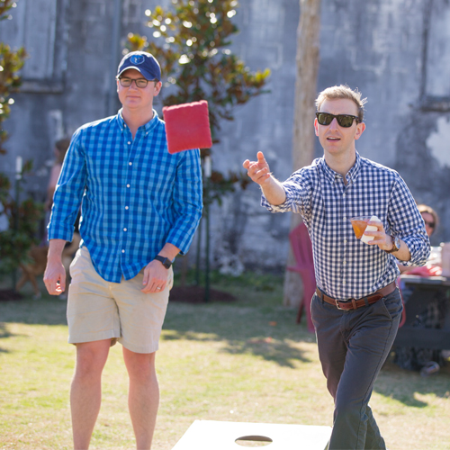 Two UTHSC residents playing cornhole