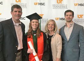 resident with her family at graduation