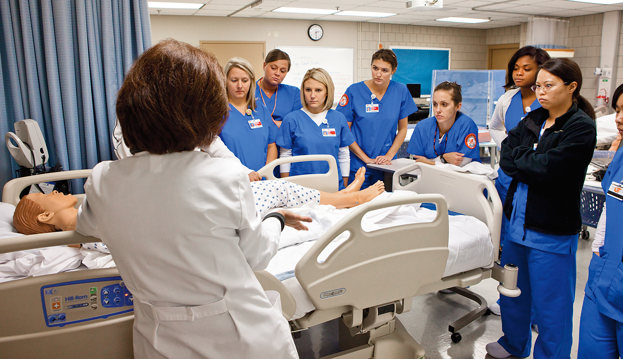 Students receive instruction bedside in simulation lab.
