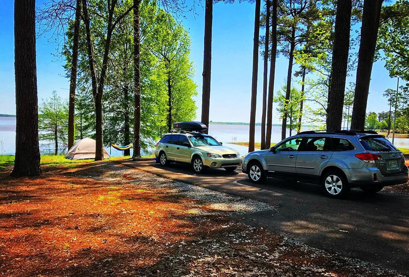 Cars and tent at the lake