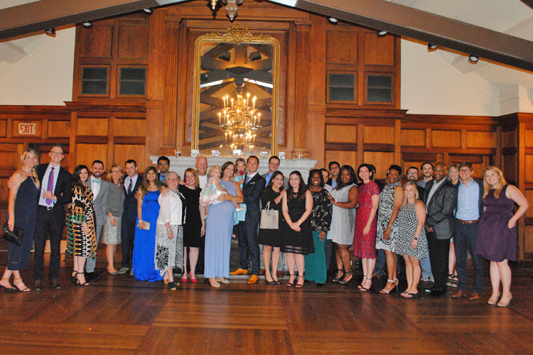 Fellows, faculty, and families at graduation