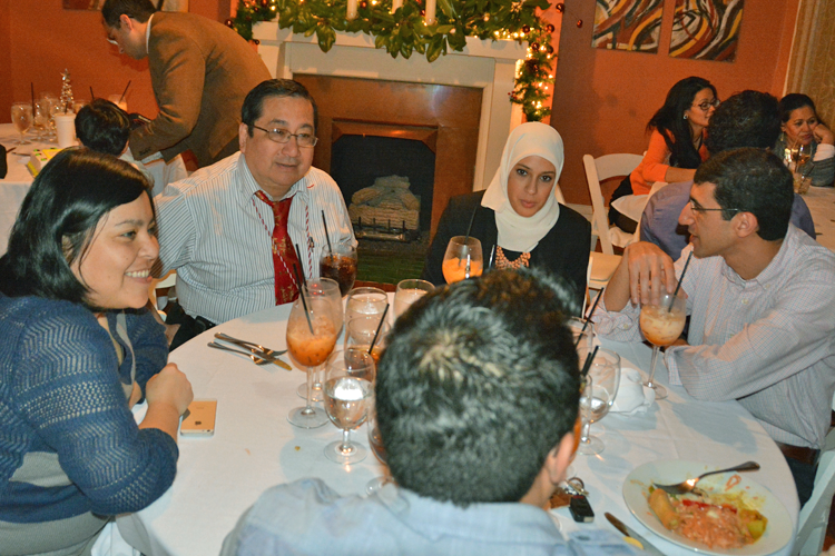 Fellows and faculty gathered at a dinner table