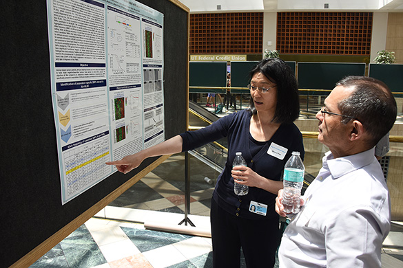 Dr. Meiyun Fan presenting during poster session