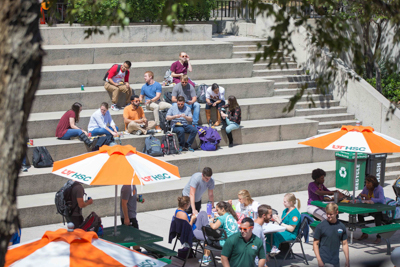 Students having lunch outside on steps.