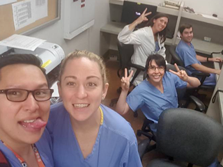 Group of smiling residents in a hospital setting